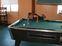 This little girl kicked many an ass in pool